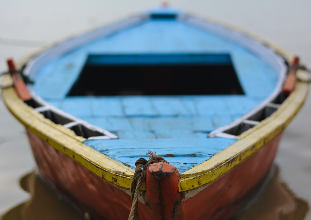close up photography of brown and blue wooden boat