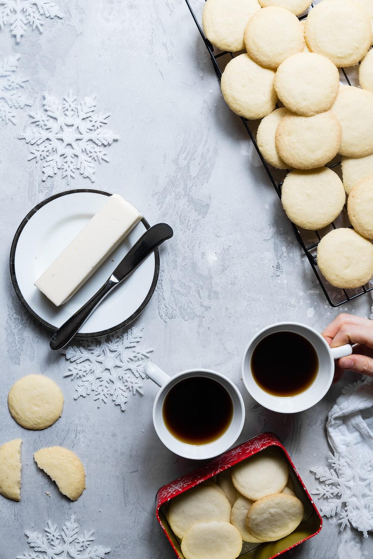 cookie lot near mug and plate