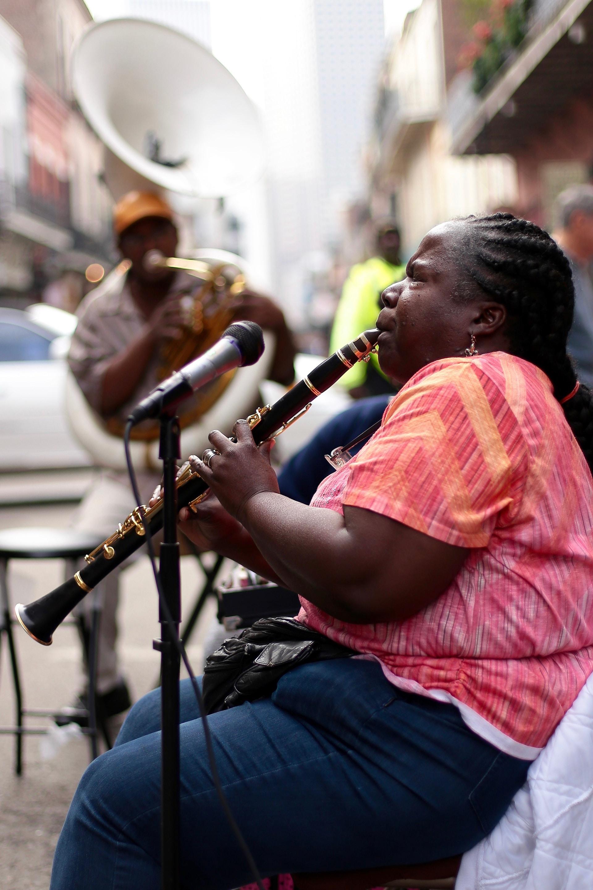 woman using black clarinet