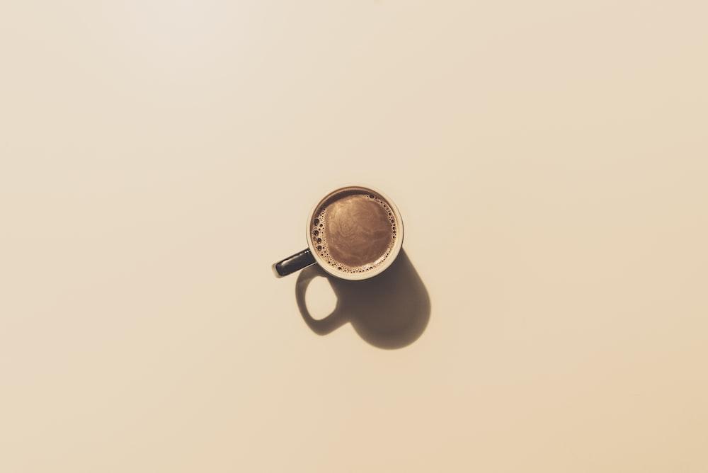 brown ceramic teacup