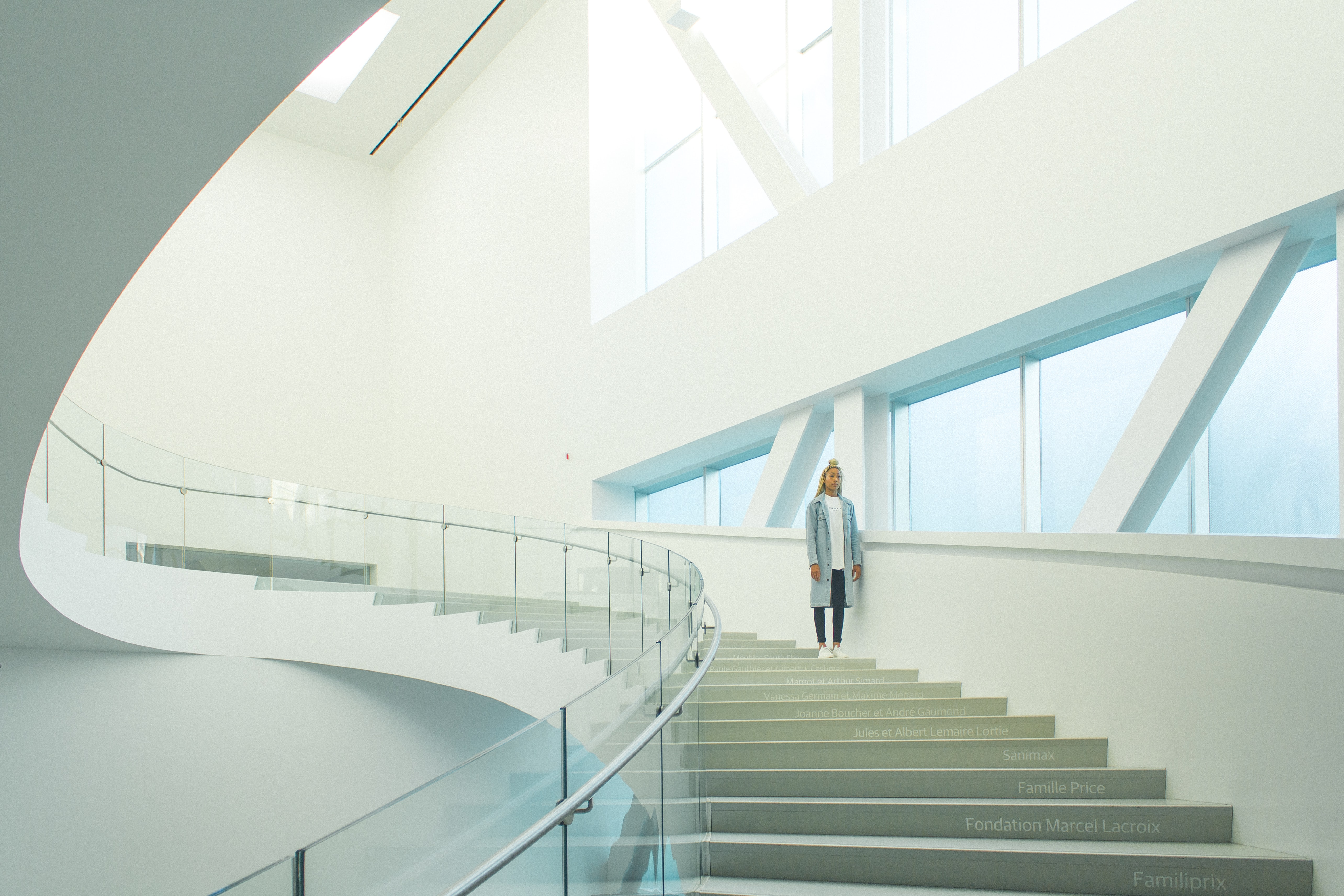 woman standing on staircase near window