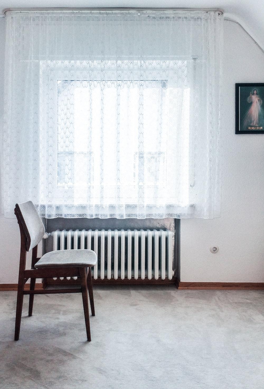 brown chair beside white radiator heater