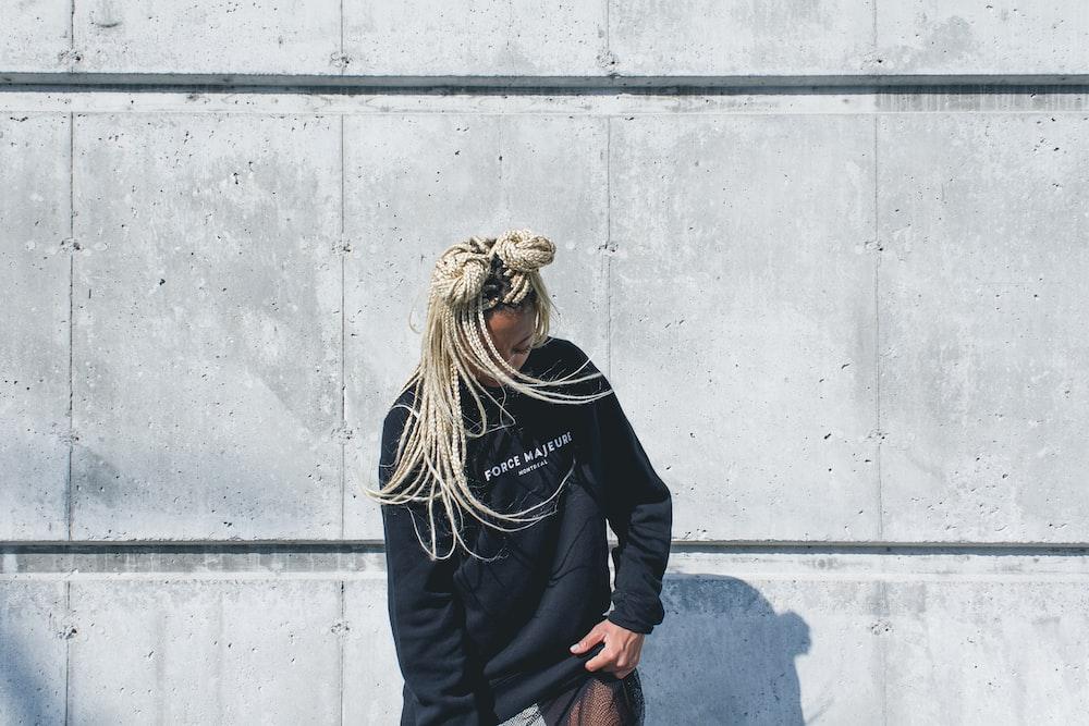 woman in black jacket looking diwn