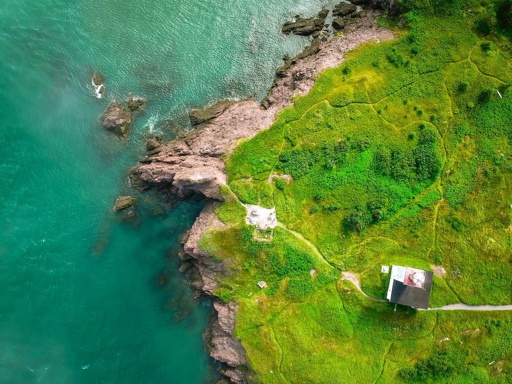 aerial photography of rocky mountain near sea