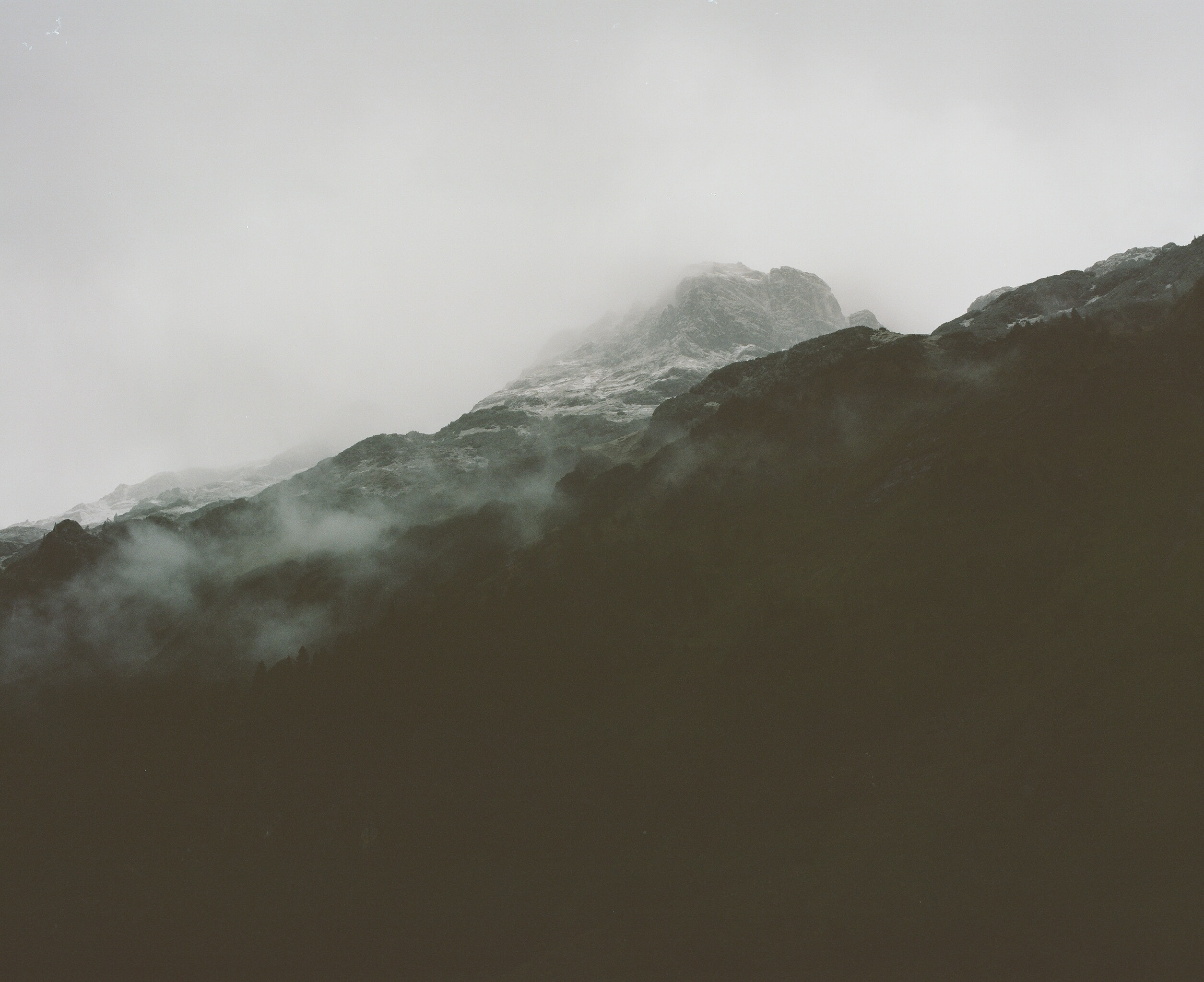 photo of mountain peak covered with fog