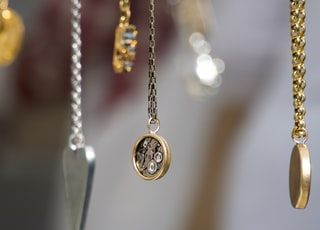 gold-and-silver-colored pendant necklace