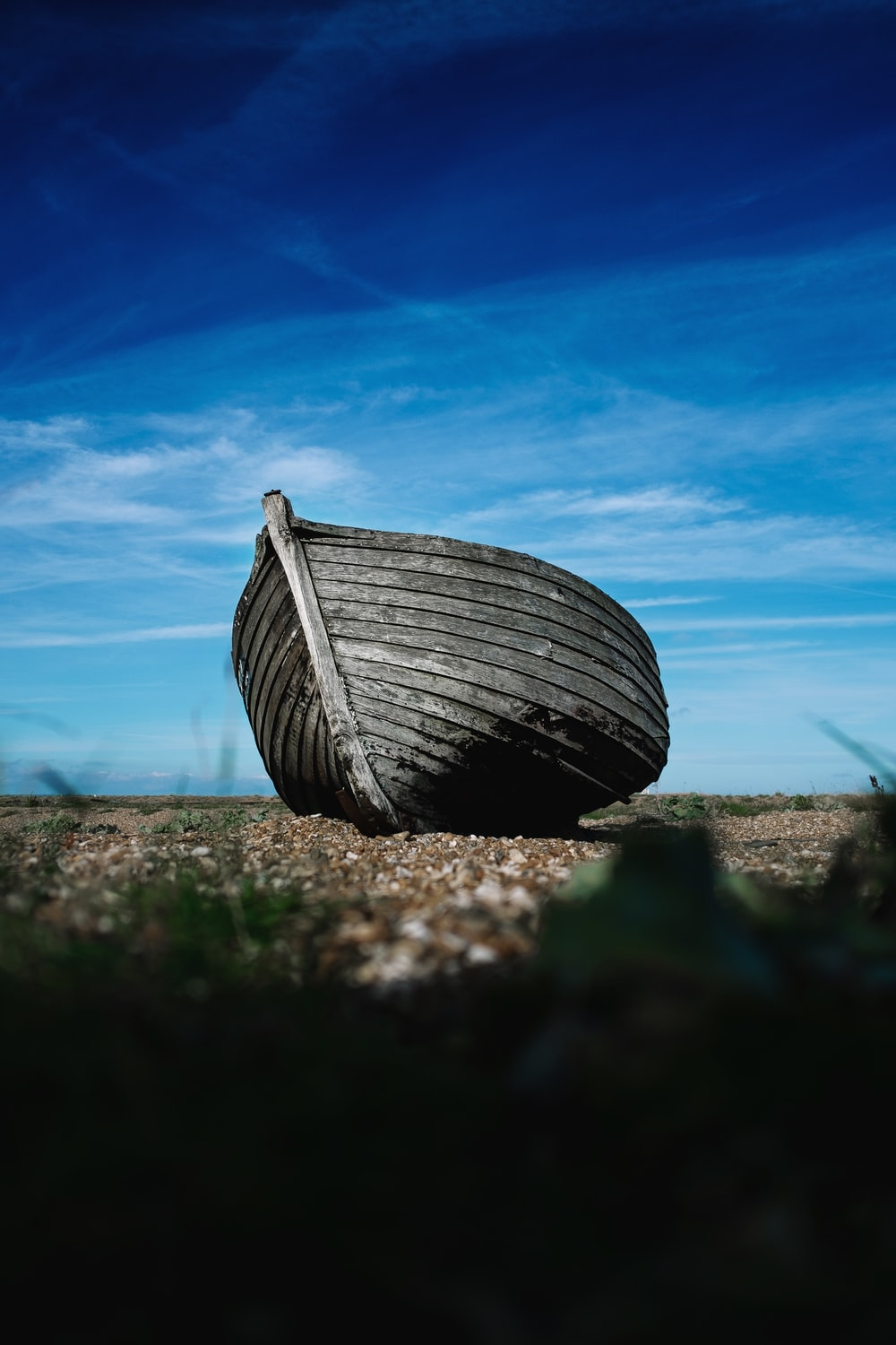 shallow focus photography of boat on coast