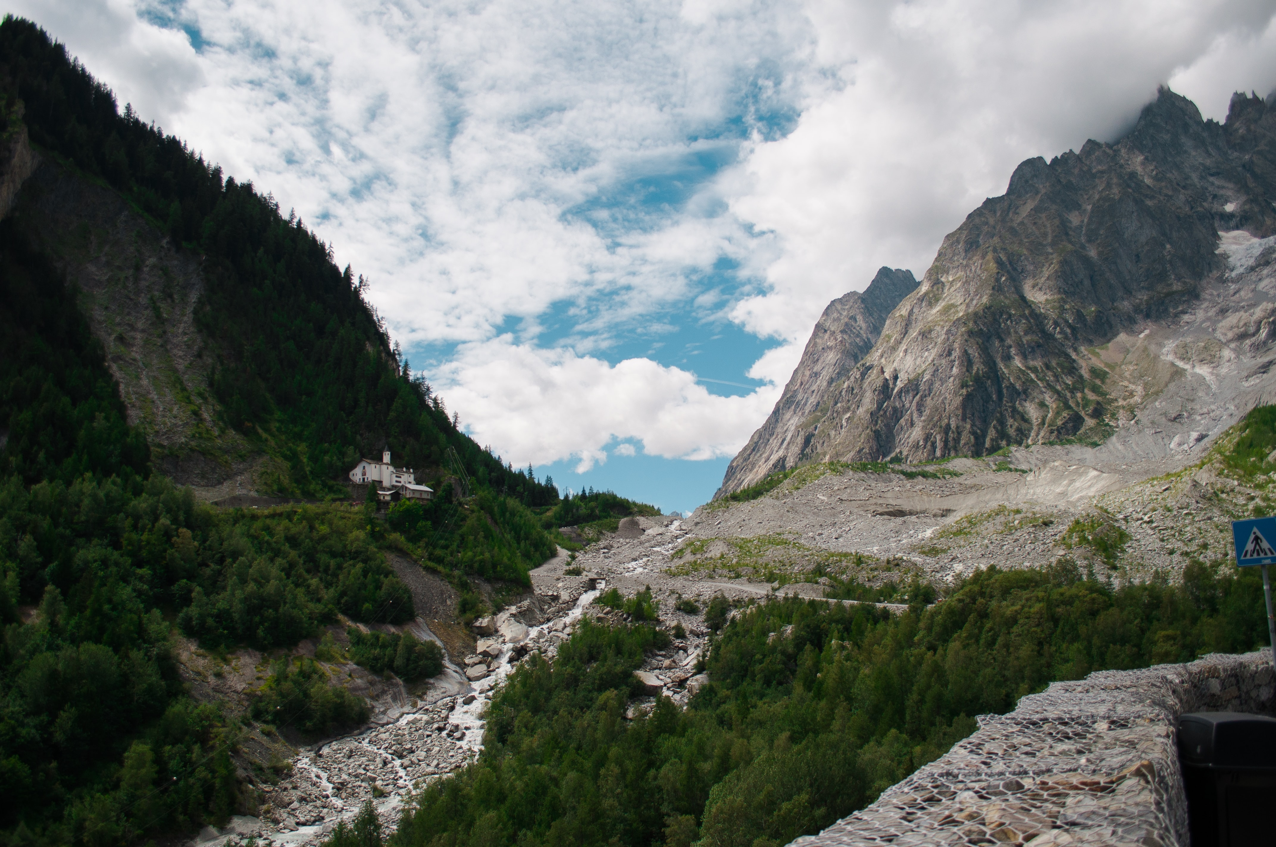 landscape photograph of river between mountain ranges