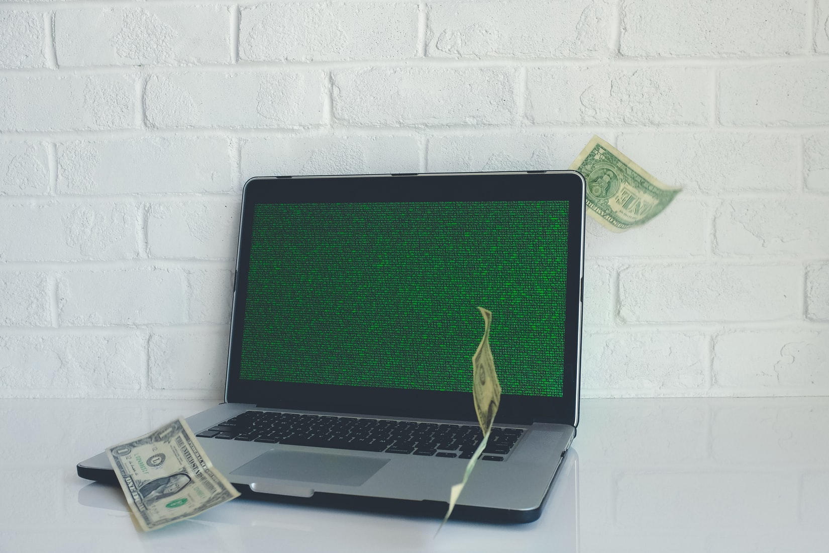lap top with money coming out