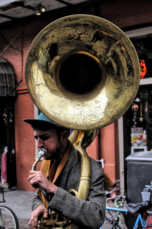 man plying trombone