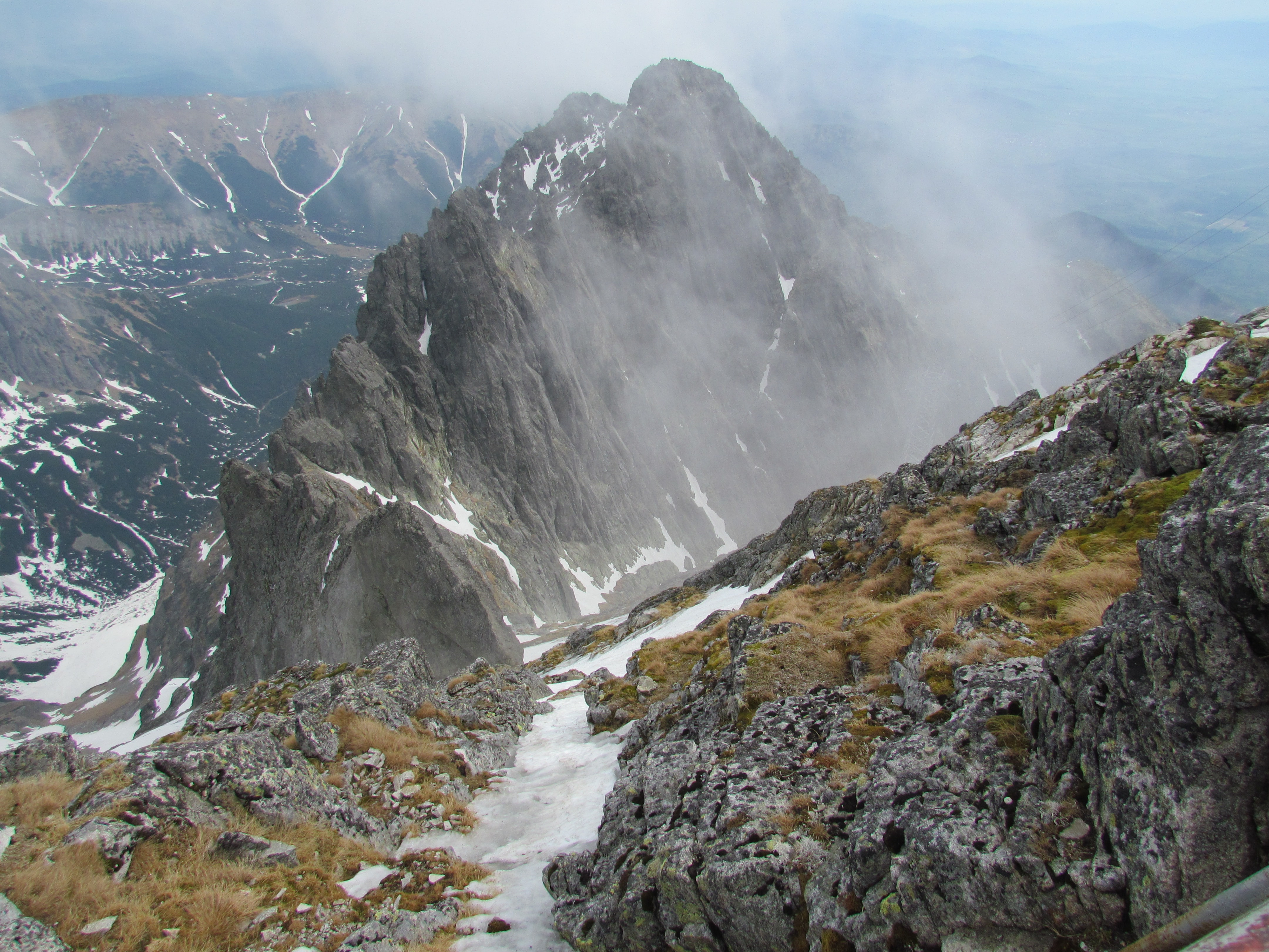 gray and white rugged mountain with mist at daytime