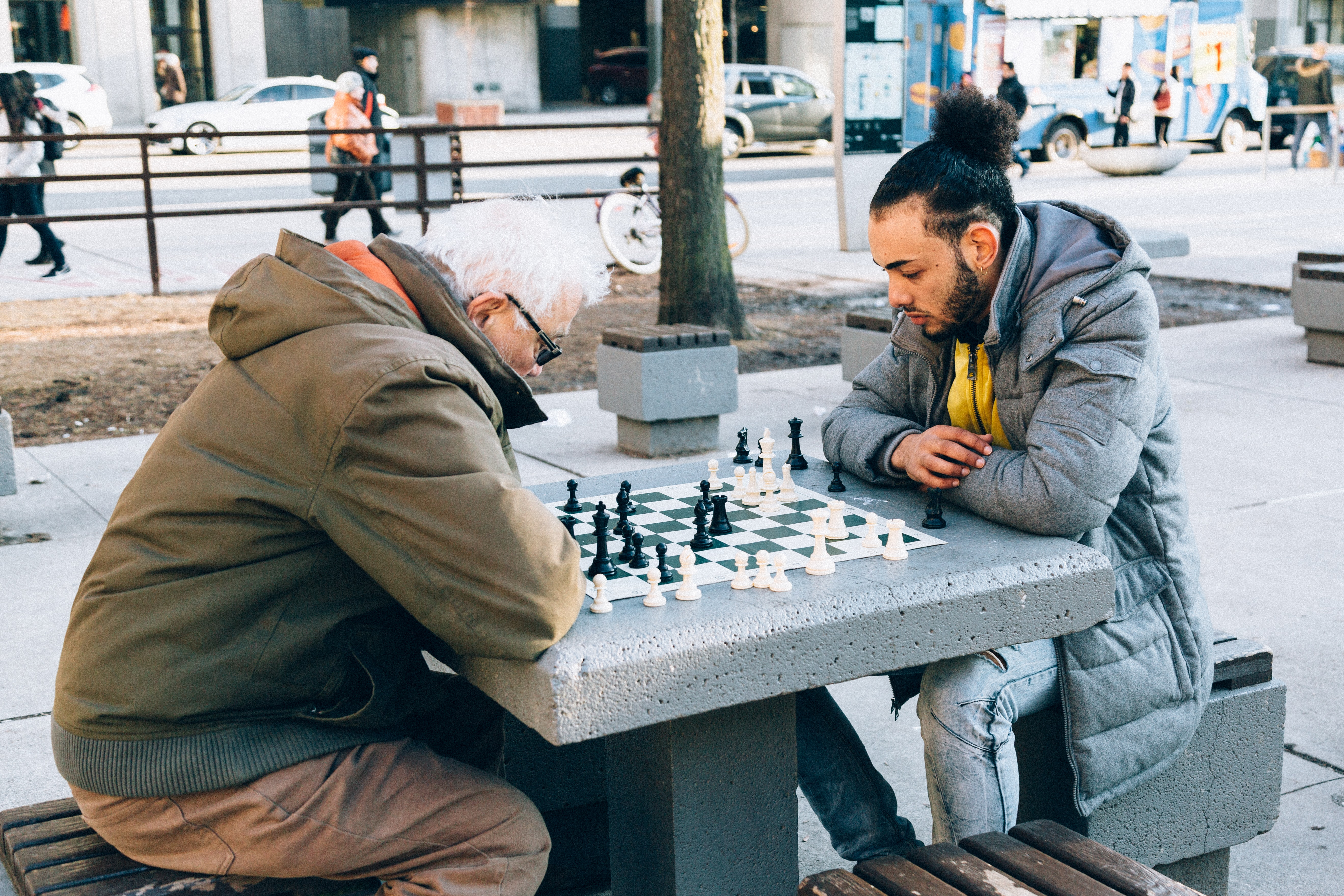 people playing chessboard game outdoor