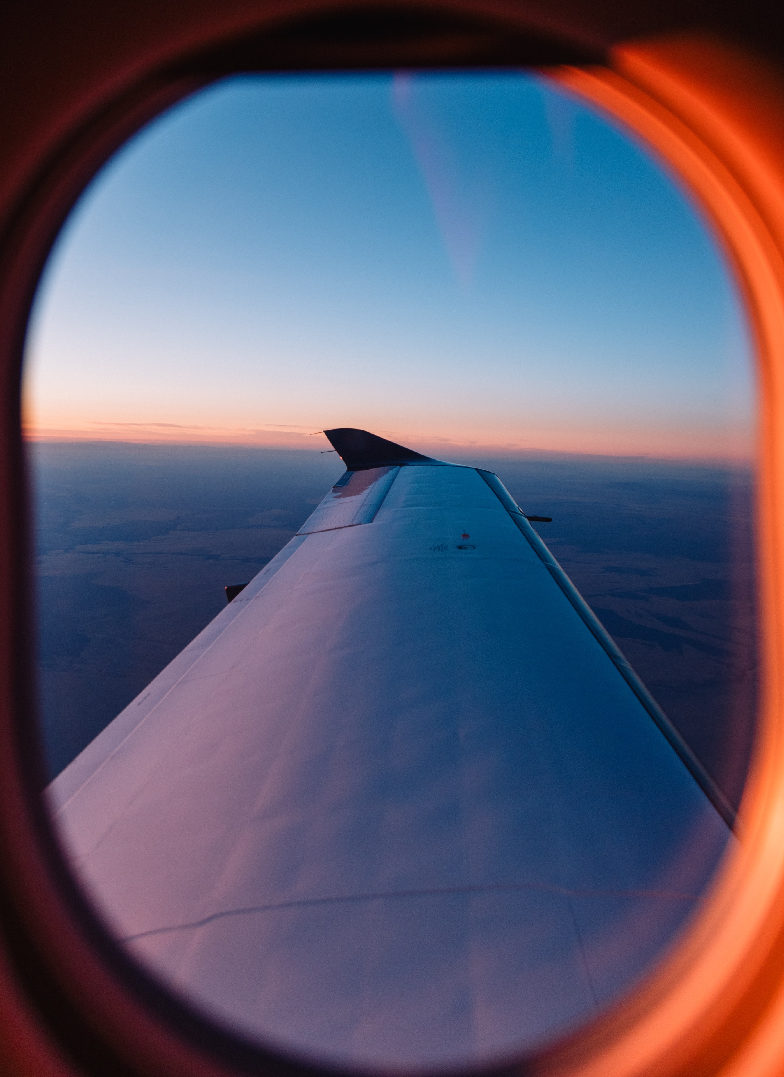 photo of left side airplane wing during daytime