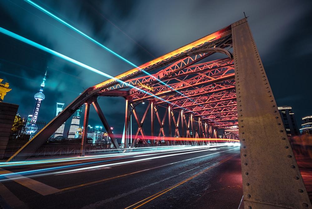 time lapse photo of bridge within Tokyo Skytree during nighttime