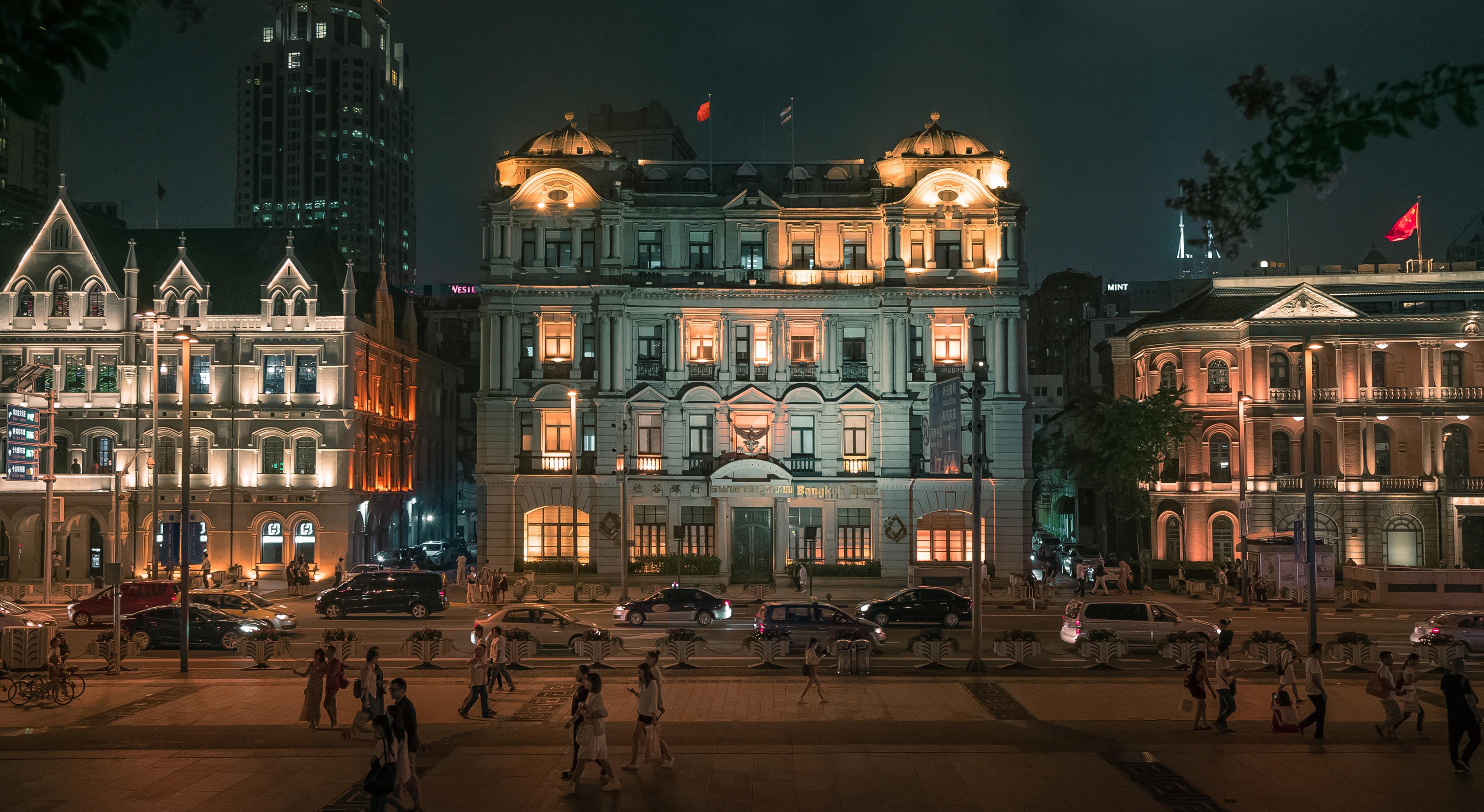 people walking in the street during nighttime