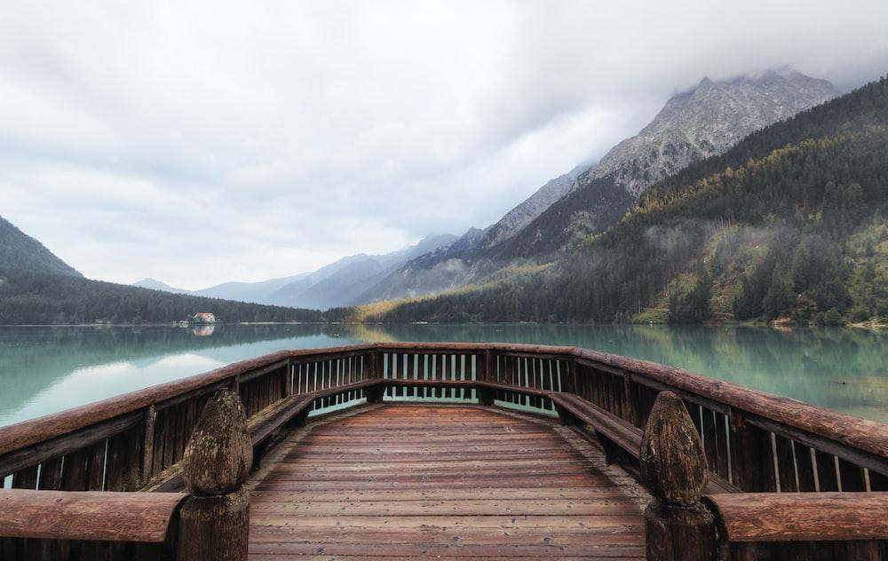 brown dock within mountain range during daytime