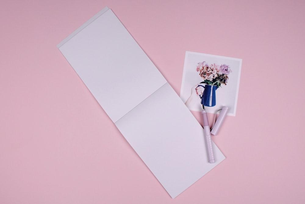 pink ballpoint pen on white printer paper