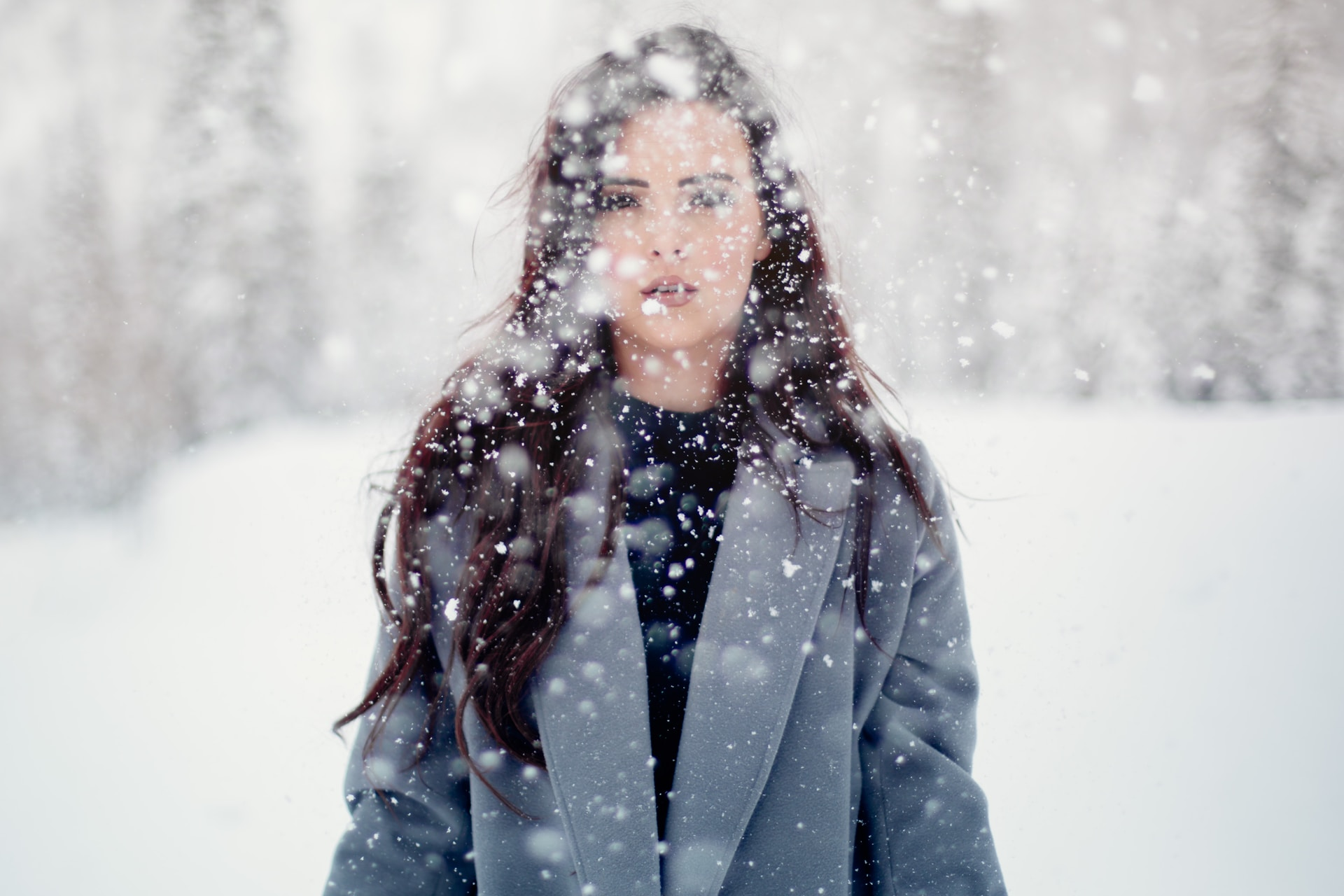 selective focus photograph of woman in gray coat