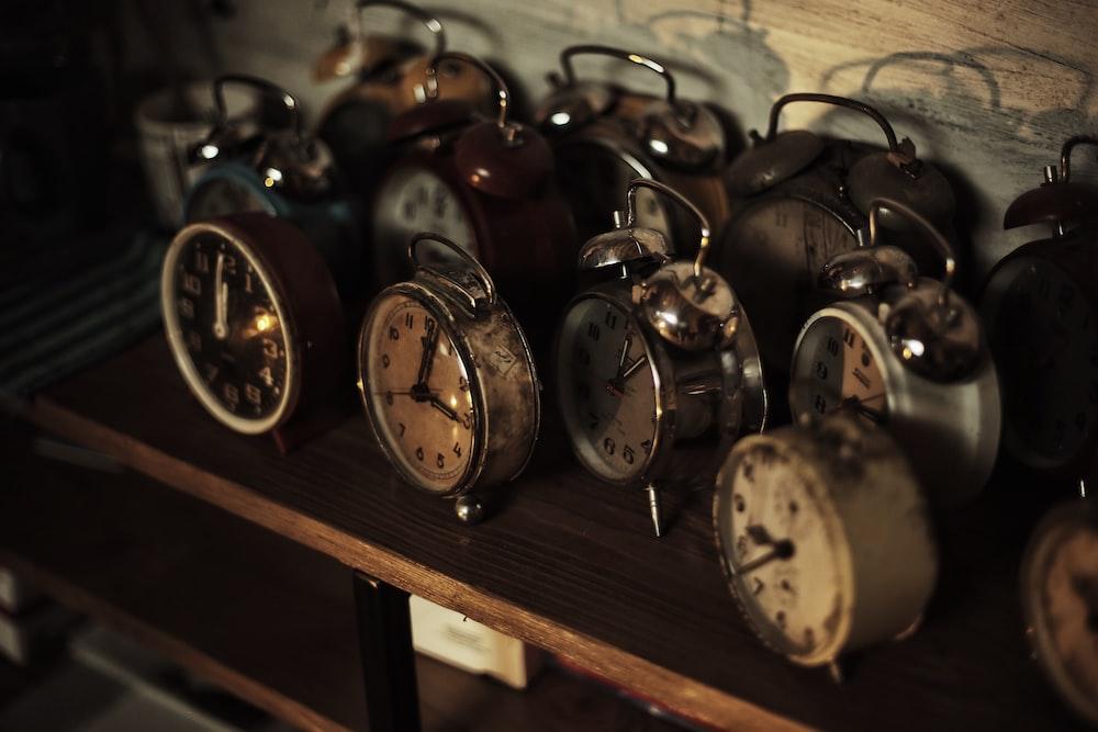 photo of analog alarm clock lot
