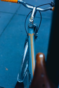 shallow focus photography of teal bicycle frame