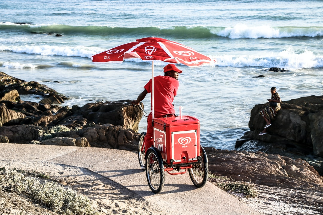 After a surf session at Bloubergstrand beach with my brother, I saw one of the Ola carts that we were familiar with as kids. I grabbed my Canon and, being a typical warm, sunny Cape Town day, I set the ISO as low as it could go to make the blacks, shadows and soft red of the Ola branding really pop.