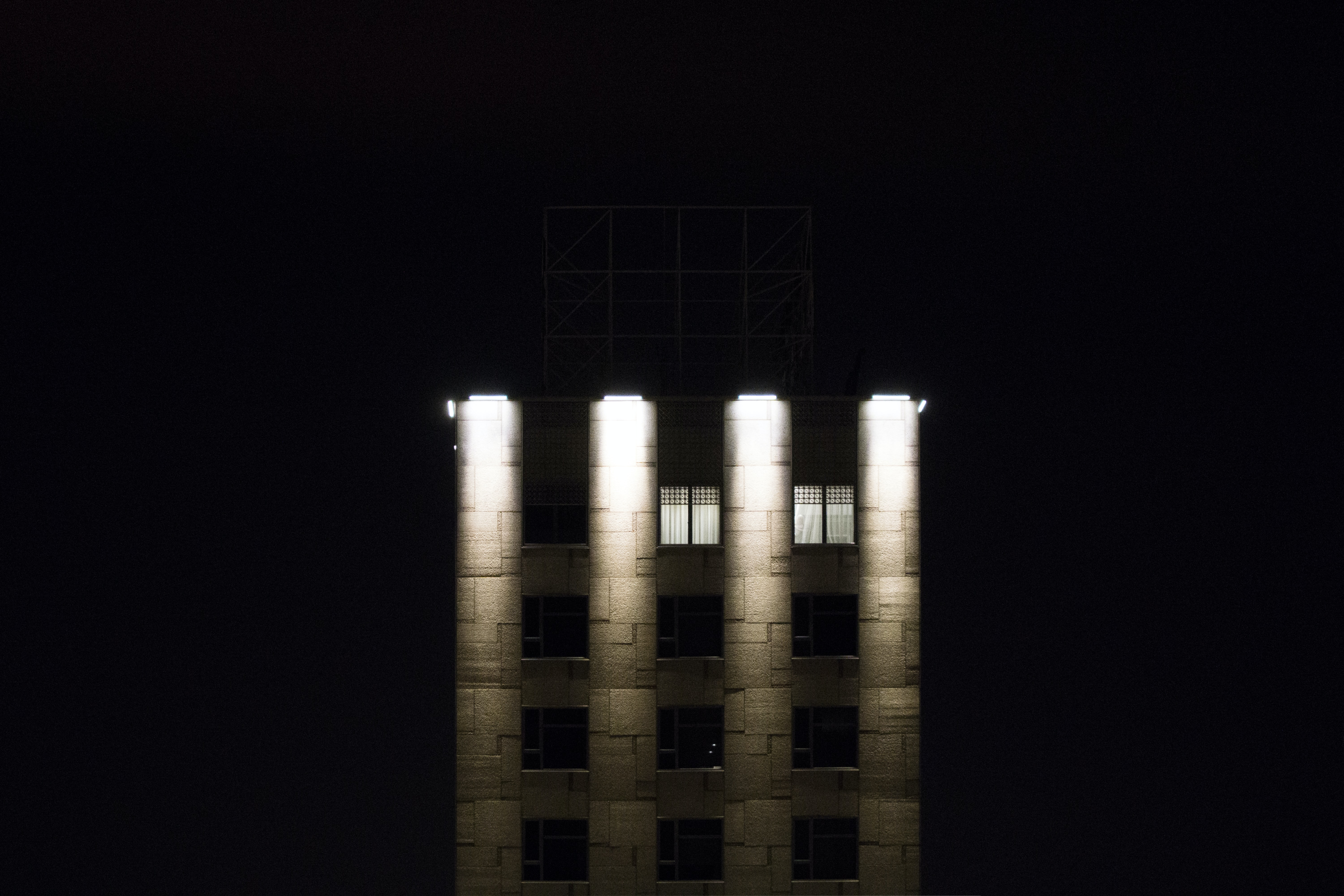 gray concrete building with four light