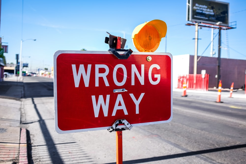 red Wrong Way signage on road