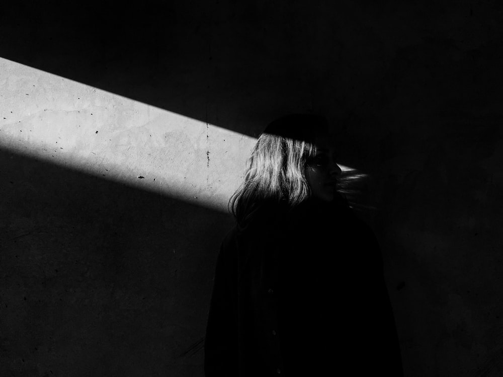 grayscale photo of woman's back