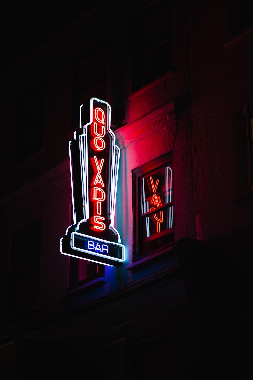 Quo Vadis bar lighted signage