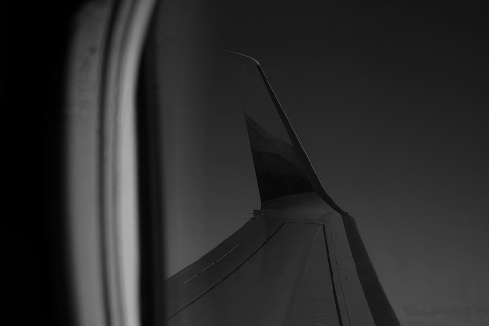 grayscale photography of plane wing