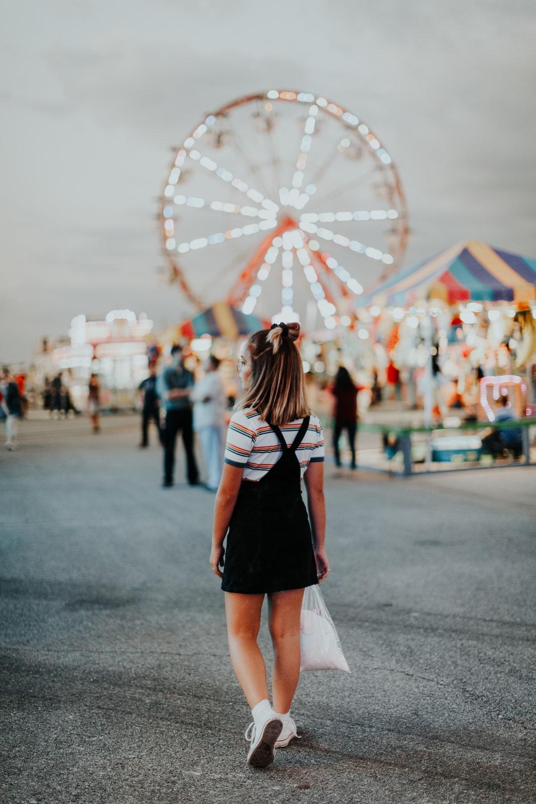 girl walking at fair