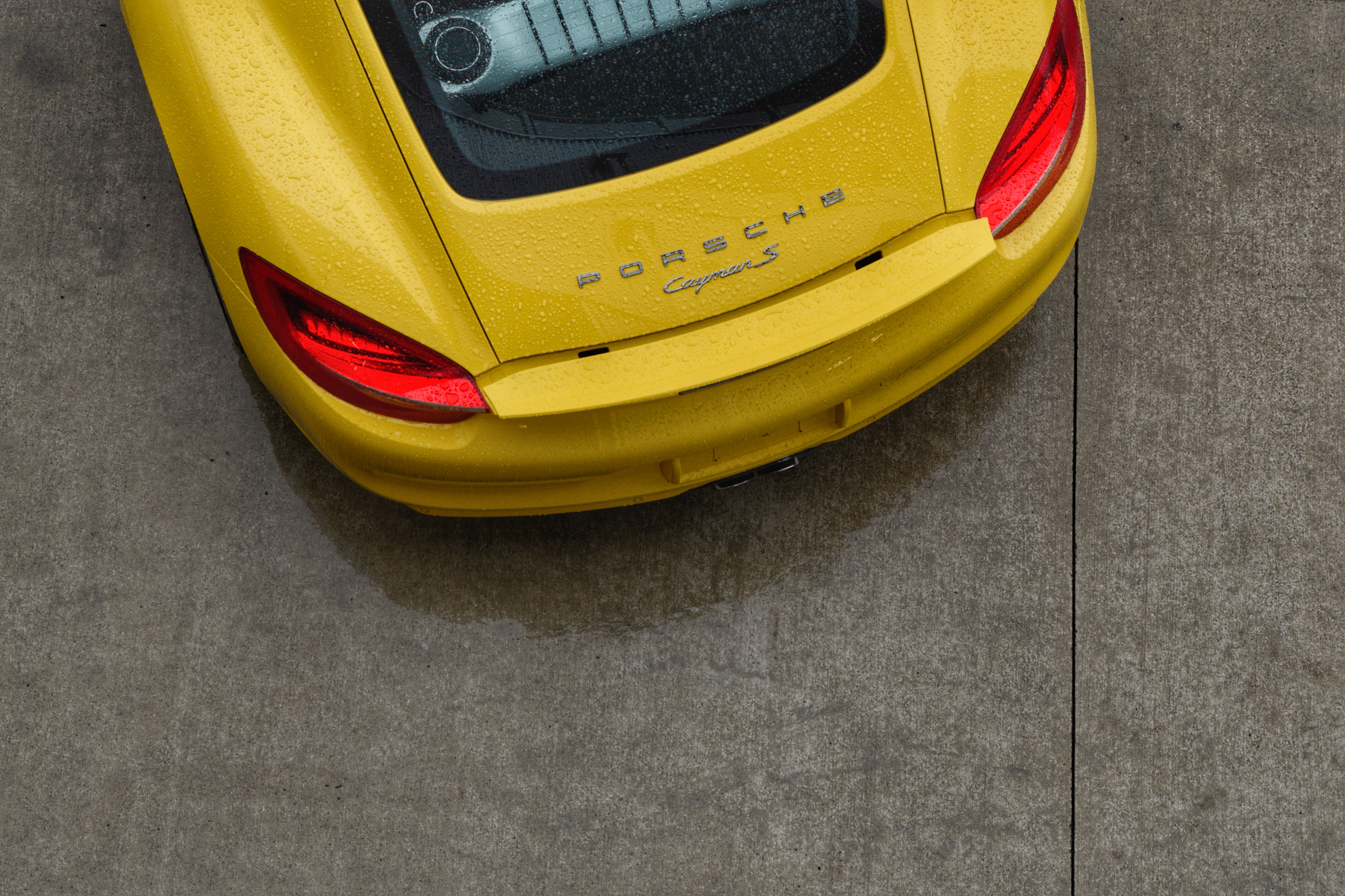 yellow Porche car parked on road