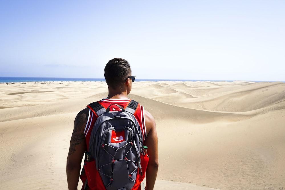 man looking at desert