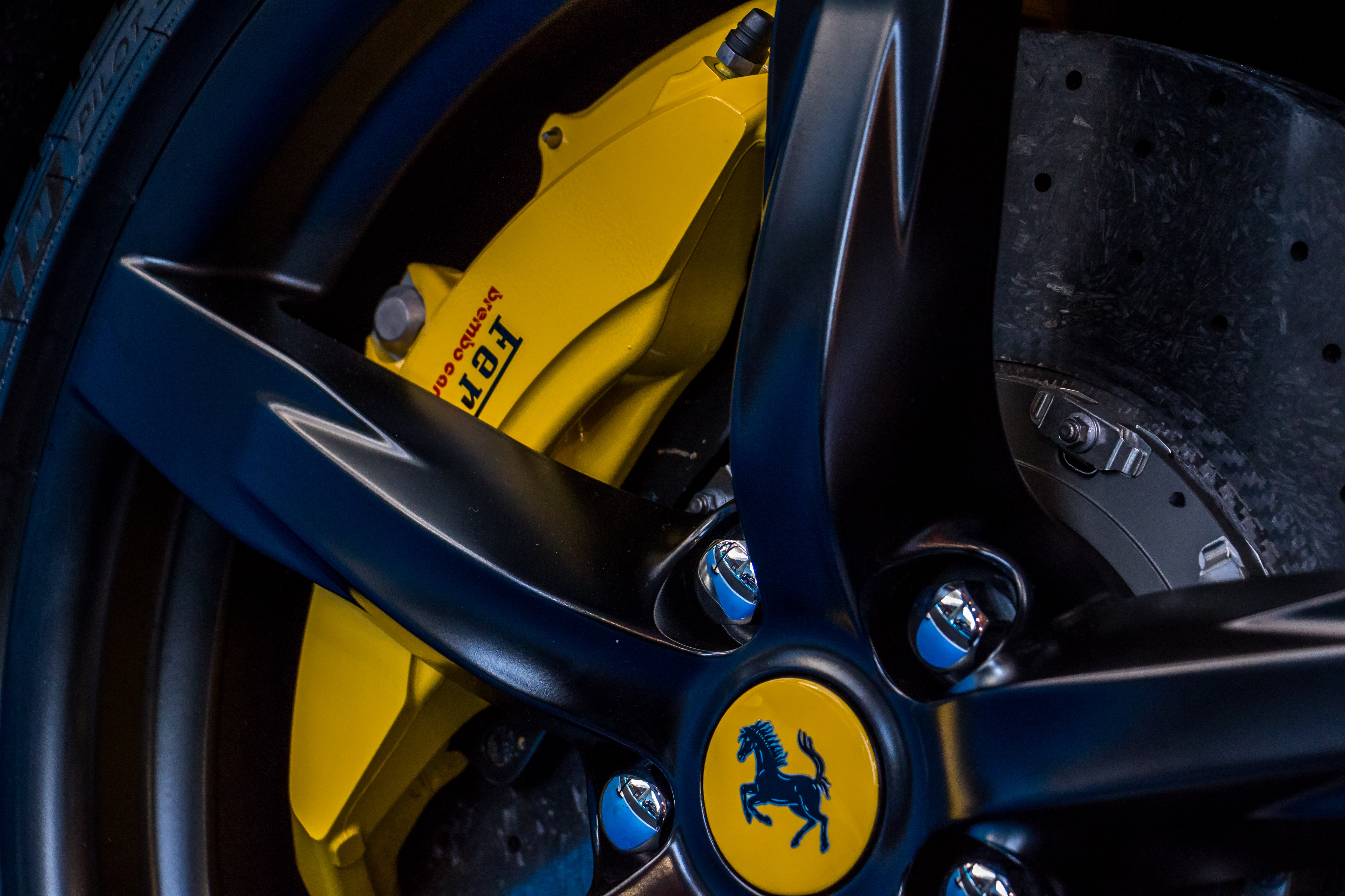 closeup photo of vehicle Ferrari wheel and tire