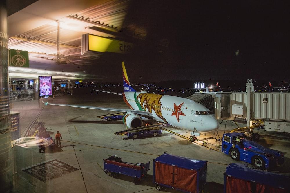 airplane near warehouse during night