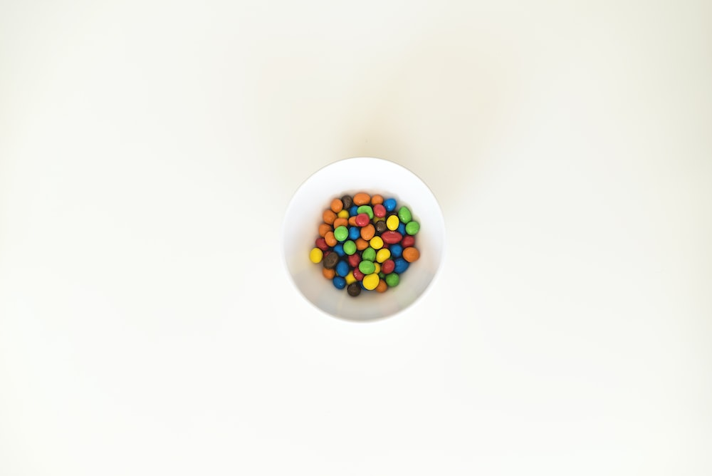 multicolored pebbles in white bowl