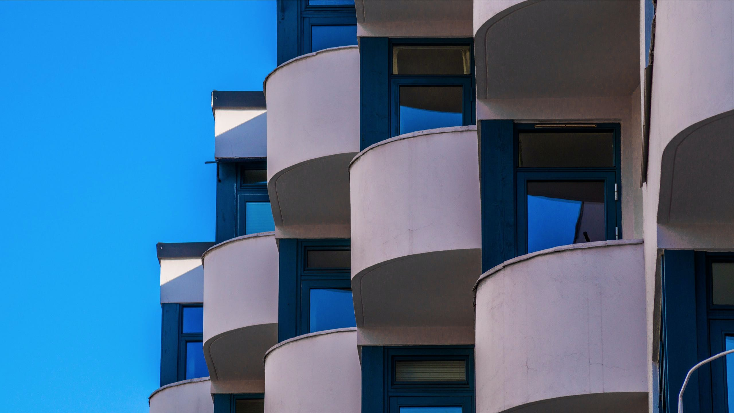 photo of white and blue concrete building