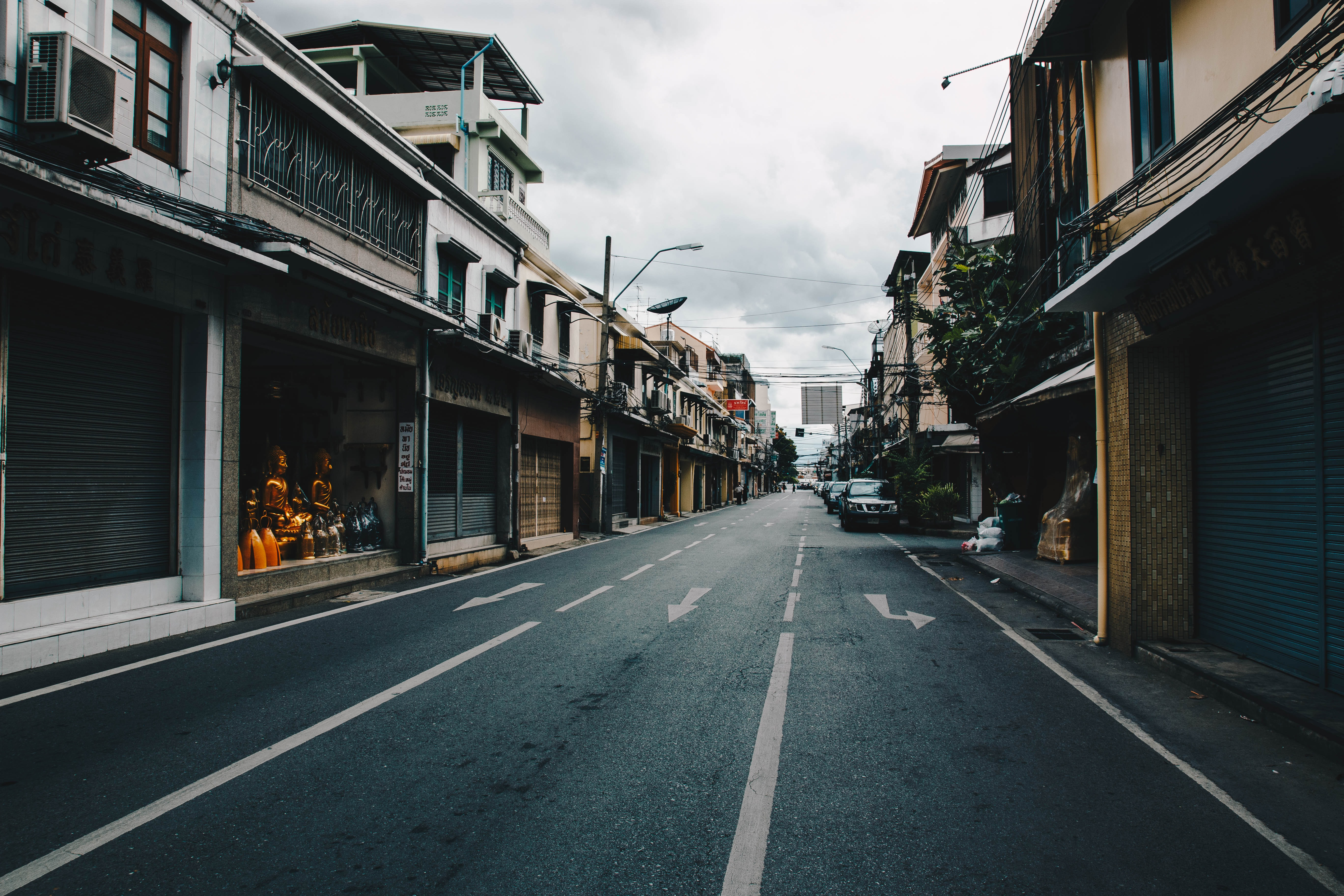 low light photography of the street under cloudy sky