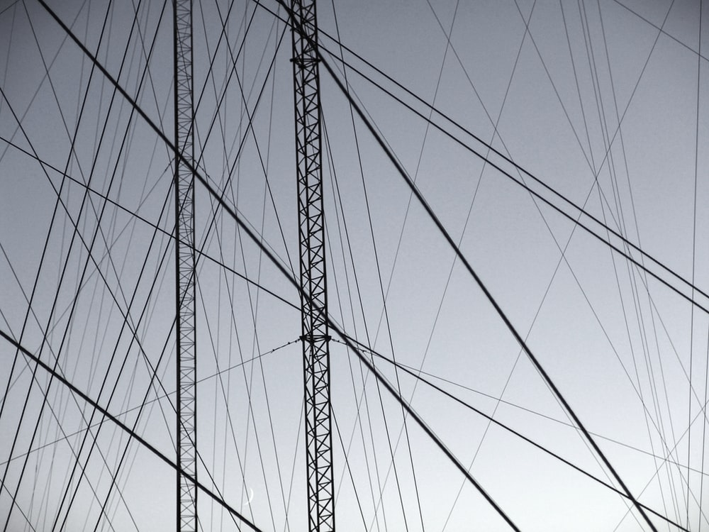 grayscale photography of gray steel structure