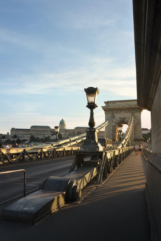 photography of people walking on gray bridge
