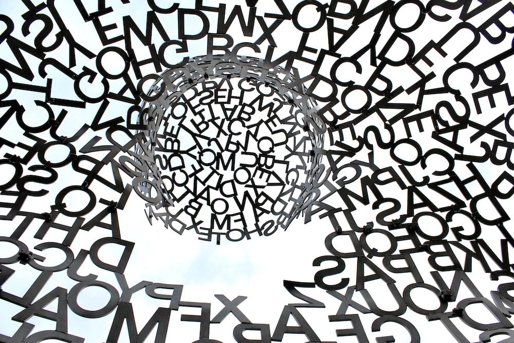 black swirl of letters