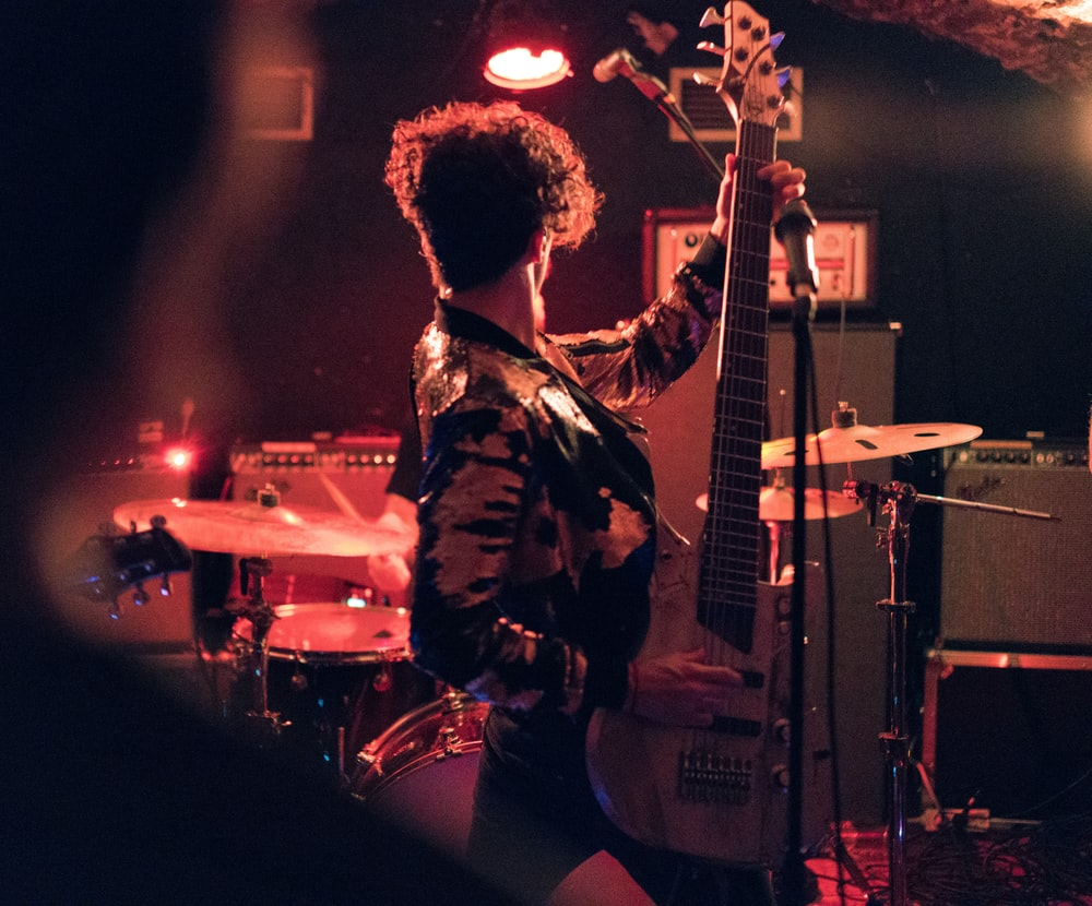 man holding electric guitar