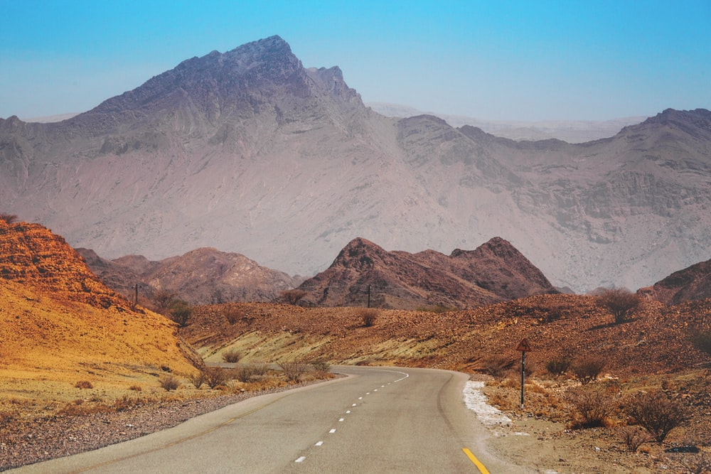 curved road surrounded by mountains