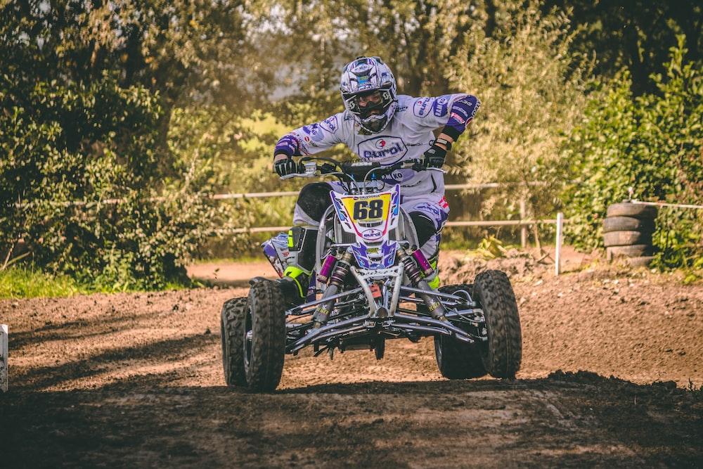 man riding ATV quad bike