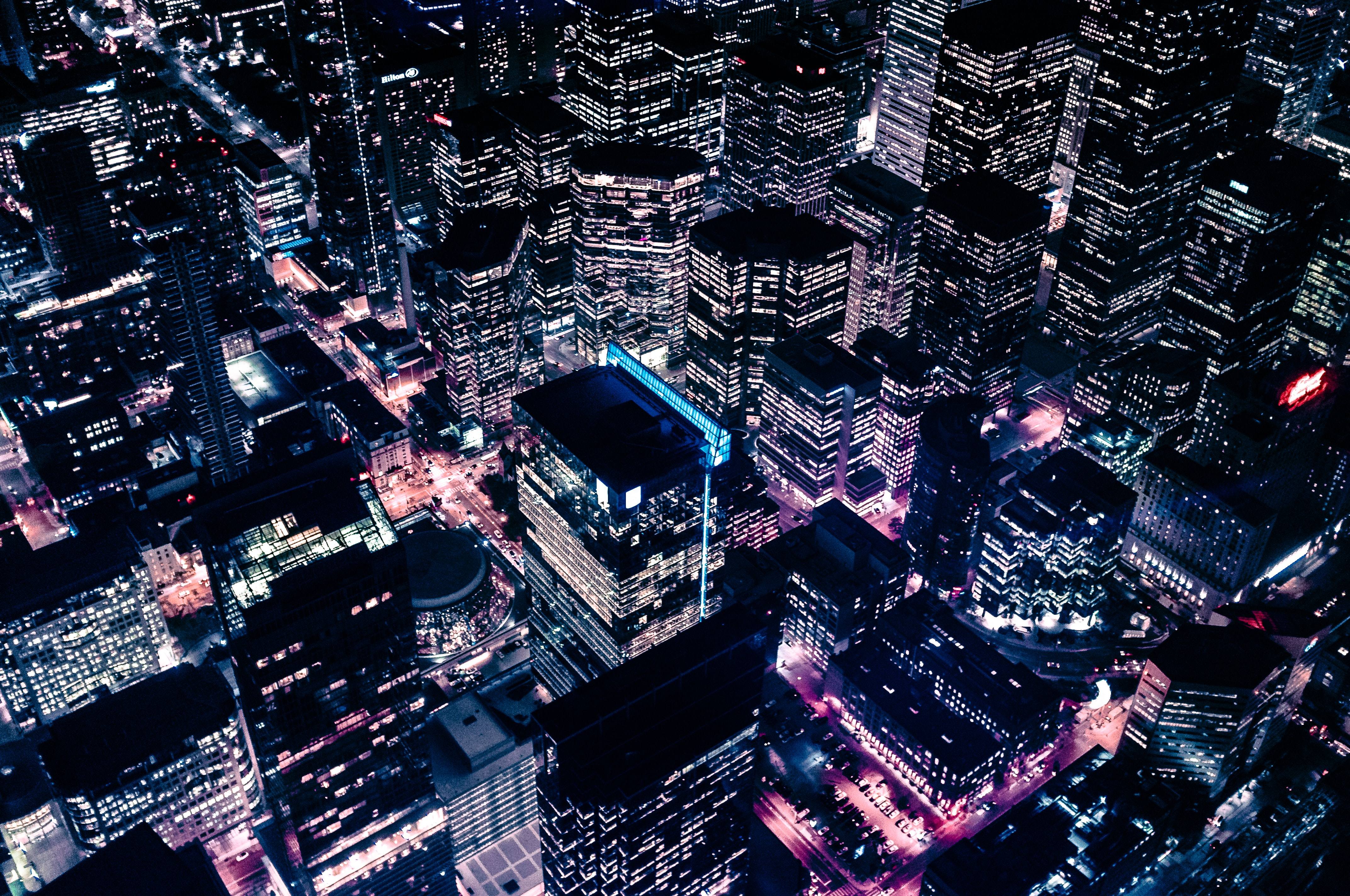 bird's eye view of lighted high-rise buildings