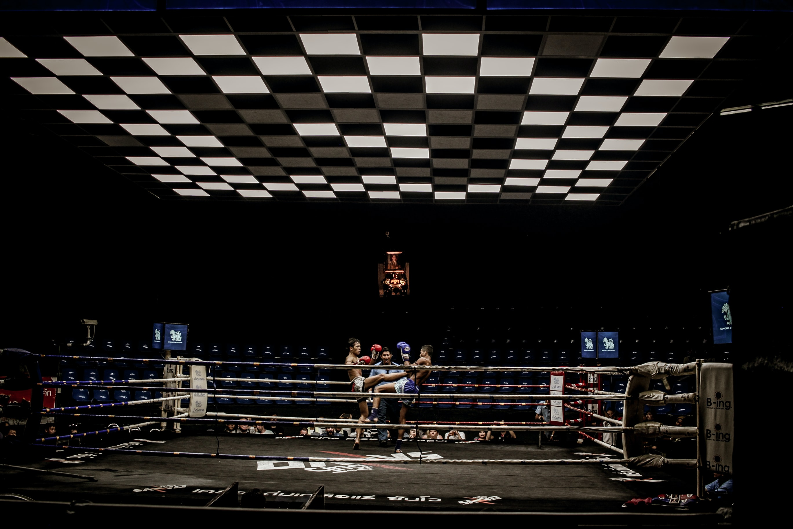 two man in blue and red pair of gloves on boxing ring