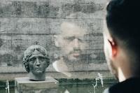 man facing head bust