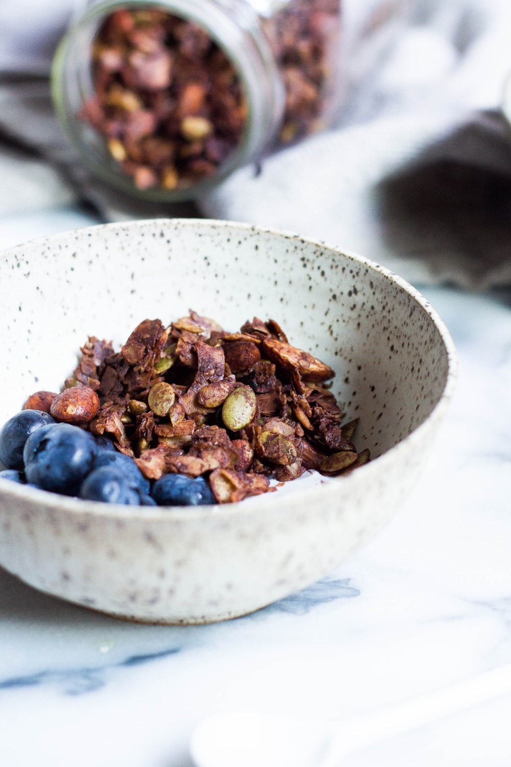 white ceramic bowl with blueberries