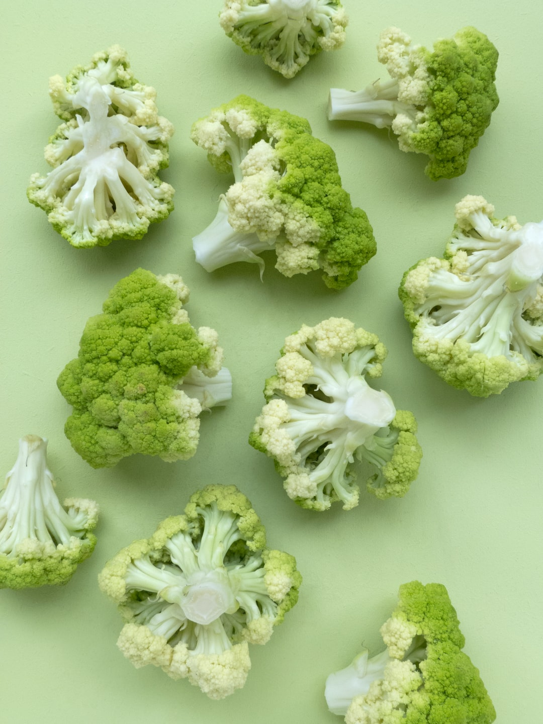 I am intrigued by the architecture of (edible) botanicals like cauliflower. And I love colour gradients, so I had to capture these cauliflower florets. I painted the backdrop in a matching green colour, styled the florets in a natural way and shot them from above. All my photos are taken with natural light.