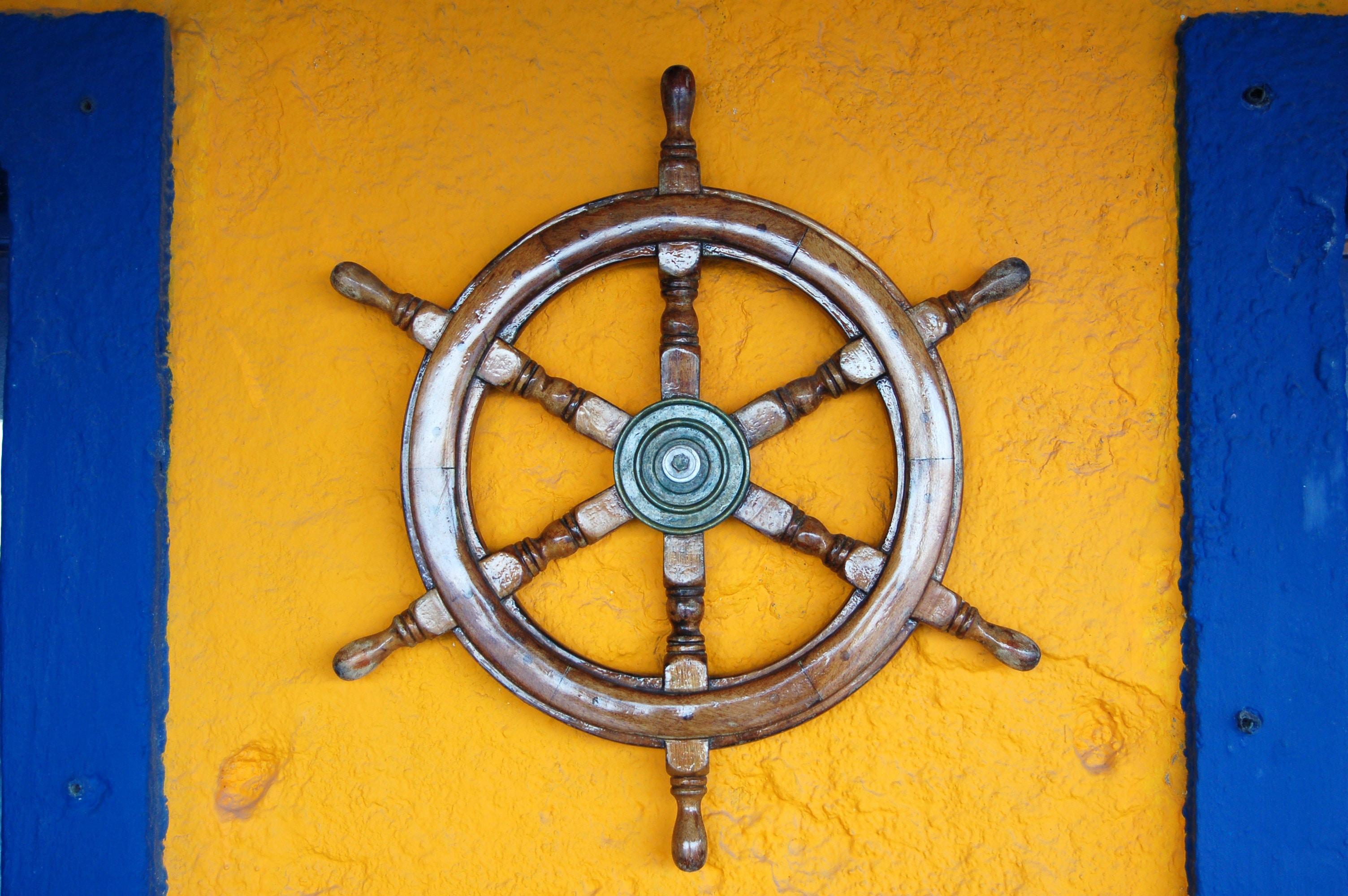 brown ship helm on wall